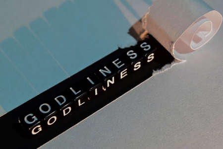 Godliness on wooden blocks. With positive vibes concept. Cross processed image. White torn paper Reklamní fotografie
