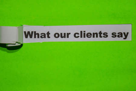 What Our Clients Say, business concept on green torn paper 写真素材