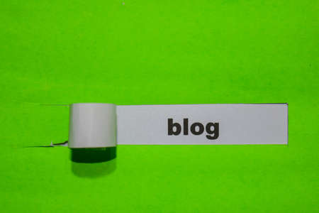 Blog, Inspiration and business concept on green torn paper