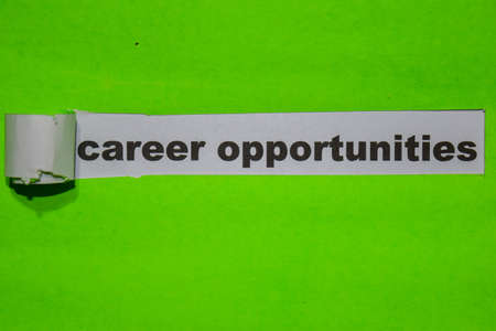 Career Opportunities, Inspiration and business concept on green torn paper