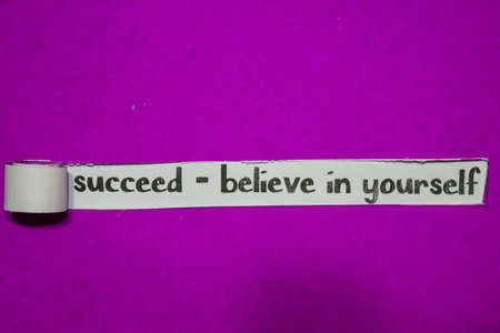 Succeed - Believe in Yourself, Inspiration, Motivation and business concept on purple torn paper