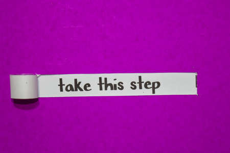 Take this step, Inspiration, Motivation and business concept on purple torn paper