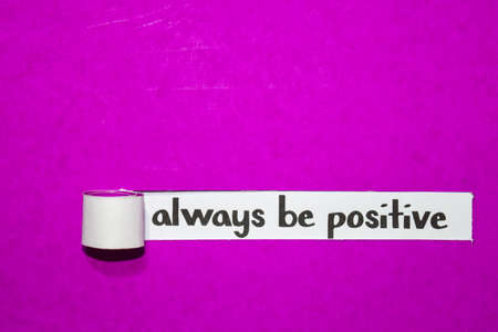 Always be positive text, Inspiration, Motivation and business concept on purple torn paper Фото со стока
