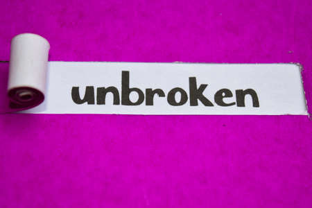 Unbroken text, Inspiration, Motivation and business concept on purple torn paper Archivio Fotografico