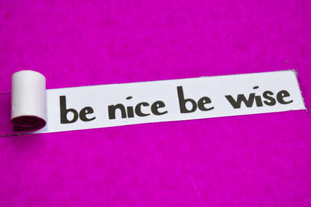 Be Nice Be Wise text, Inspiration, Motivation and business concept on purple torn paper