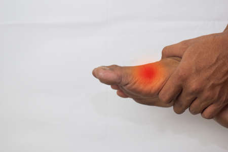 Pain in the joint of big toe can be discouraging Stockfoto