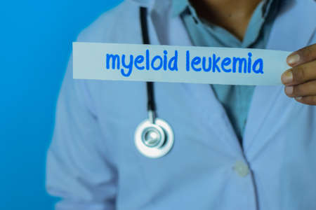 Doctor holding a card with text myeloid leukemia. Medical and healthcare concept.