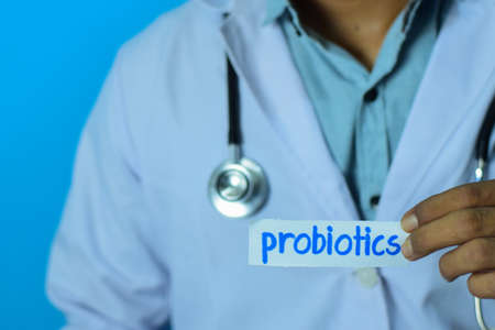 Doctor holding a card with text probiotics. Medical and healthcare concept.