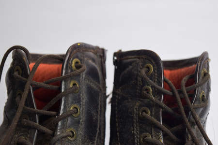 Close up of a brown old boots isolated on white background