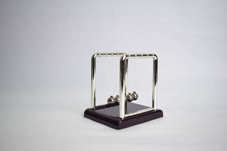 Newton's cradle work. Education, science and physics concept isolated white background