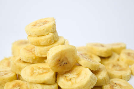 Close up slice yellow banana isolated on white background