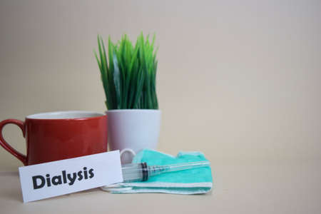 Dialysis text, grass pot, coffee cup, syringe, and face green mask. Healtcare/Medical and Business concept