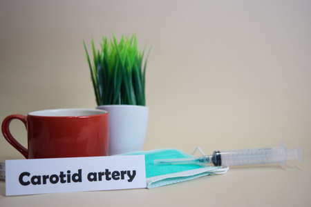 Carotid artery text, grass pot, coffee cup, syringe, and face green mask. HealtcareMedical and Business concept