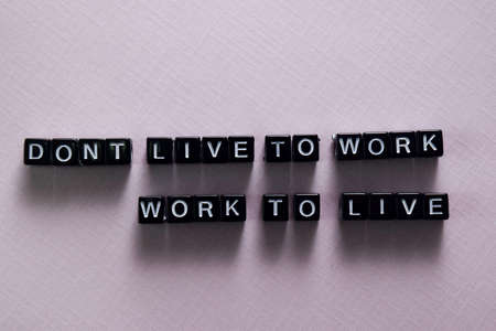 Dont live to work. Work to live on wooden blocks. Motivation and inspiration concept