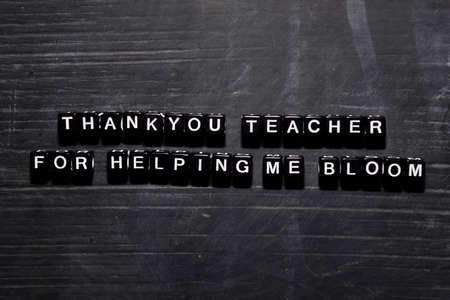Thank you teacher for helping me bloom on wooden blocks. Education, Motivation and inspiration concept