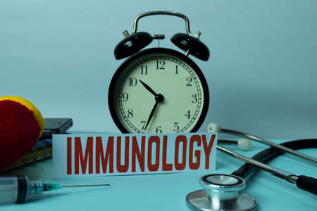 Immunology Planning on Background of Working Table with Office Supplies. Medical and Healthcare Concept Planning on White Background