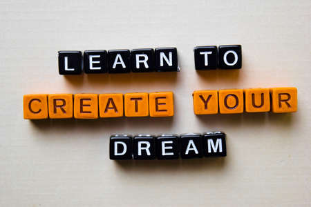 Learn to Create Your Dream on wooden blocks. Business and inspiration concept Reklamní fotografie