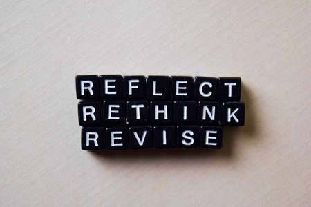 Reflect - Rethink - Revise on wooden blocks. Business and inspiration concept Imagens