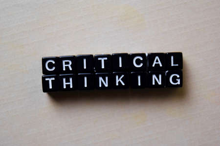 Critical Thinking on wooden blocks. Business and inspiration concept Banque d'images