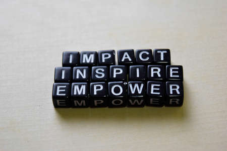 Impact - Inspire - Empower on wooden blocks. Business and inspiration concept Banque d'images - 123157277