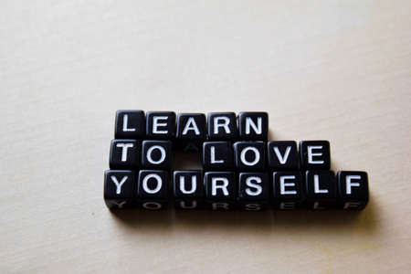 Learn to Love Yourself on wooden blocks. Business and inspiration concept