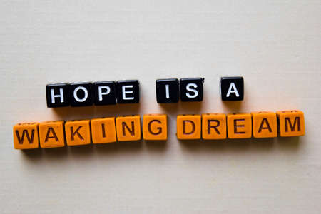 Hope is a Waking Dream on wooden blocks. Business and inspiration concept Banque d'images - 123157346
