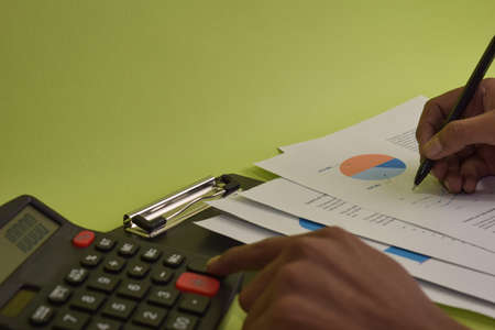 Man calculate budget cost and analysis financial. Selective focus on pen. Business and finance concept of office desk
