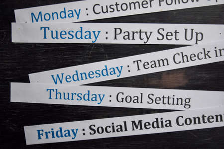Close up making agenda weekly schedule on personal organizer. Business and entrepreneur concept. Isolated on a blackboard