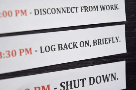Close up making agenda Daily schedule on personal organizer. Business and entrepreneur concept. Isolated on a black background