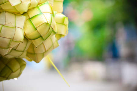 Ketupat or rice dumpling. Ketupat is a natural rice casing made from young coconut leaves for cooking rice during eid Mubarak Eid ul Fitr
