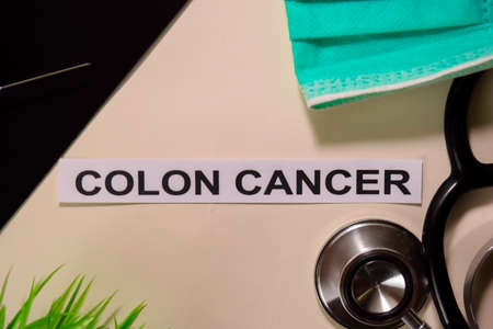 COLON CANCER with inspiration and healthcaremedical concept on desk background Stock Photo
