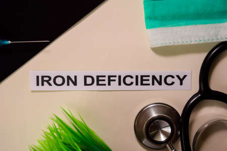 IRON DEFICIENCY with inspiration and healthcaremedical concept on desk background