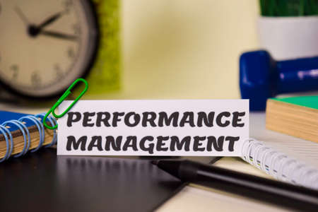 Performance Management on the paper isolated on it desk. Business and inspiration concept Imagens