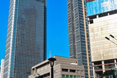 JAKARTA, INDONESIA, JUNE 8, 2019 : modern glass and steel office buildings low angle skyscraper view at Jakarta, Indonesia Standard-Bild - 124414150