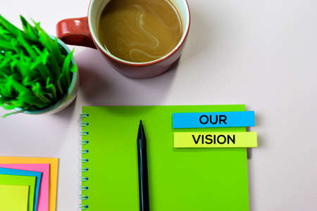 Our Vision text on sticky notes with office desk concept Stock Photo
