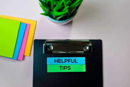 Helpful Tips text on sticky notes with office desk concept Stock Photo