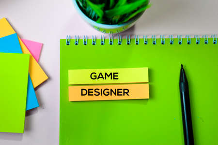Game Designer text on sticky notes with office desk concept