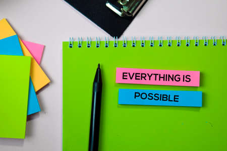 Everything is Possible text on sticky notes with office desk concept