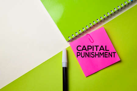 Capital Punishment text on top view office desk table of Business workplace and business objects.