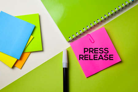 Press Release text on top view office desk table of Business workplace and business objects. Banque d'images