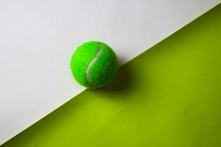 Tennis ball on top view office desk table of Business workplace and business objects.