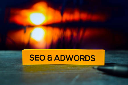 Seo & Adwords on the sticky notes with bokeh background