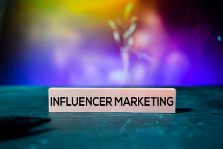 Influencer Marketing on the sticky notes with bokeh background
