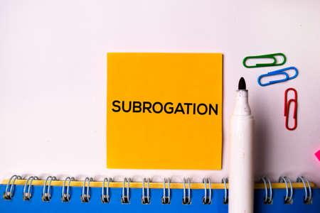 Subrogation on sticky notes isolated on white background. Standard-Bild