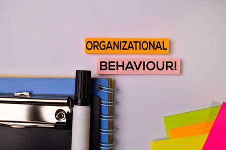 Organizational Behaviour! on sticky notes isolated on white background.