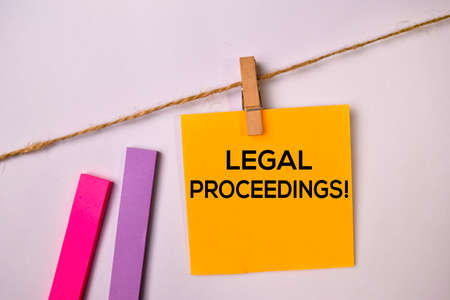 Legal Proceedings! on sticky notes isolated on white background. Фото со стока