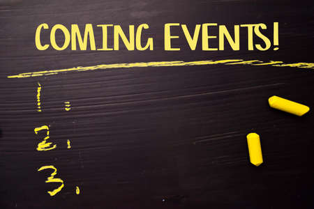 Coming Events! written with color chalk. Supported by an additional services. Blackboard concept