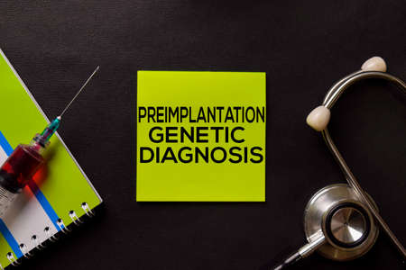 Preimplantation Genetic Diagnosis on top view black table with blood sample and Healthcare/medical concept.
