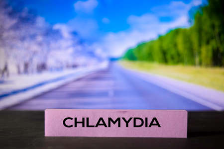 Chlamydia on the sticky notes with bokeh background Фото со стока