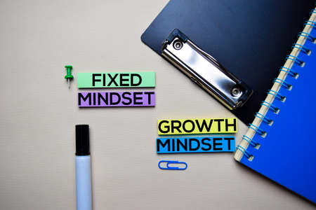 Fixed Mindset or Growth Mindset text on sticky notes with office desk concept